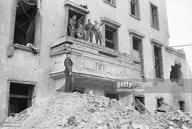 The Capture And Aftermath Of War 19451947 British and Russian soldiers on the balcony of the Chancellery the spot from which Hitler made many of his...