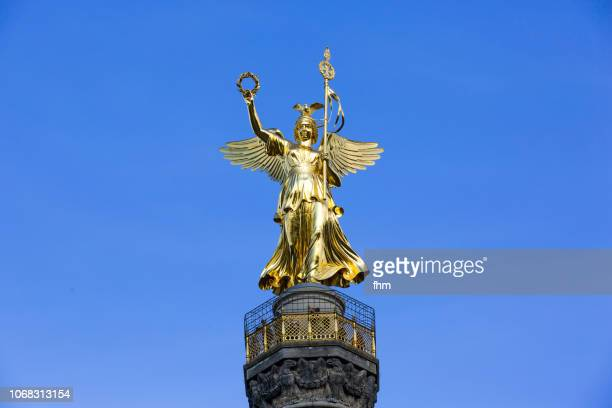 """berlin - the golden sculpture (german: goldelse) on the """"siegessäule"""" (victory column); berlin/ germany - roman goddess stock pictures, royalty-free photos & images"""
