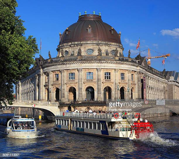 Berlin tourism wiith excursion boat on River Spree at the Museum Island and Bode Mueum