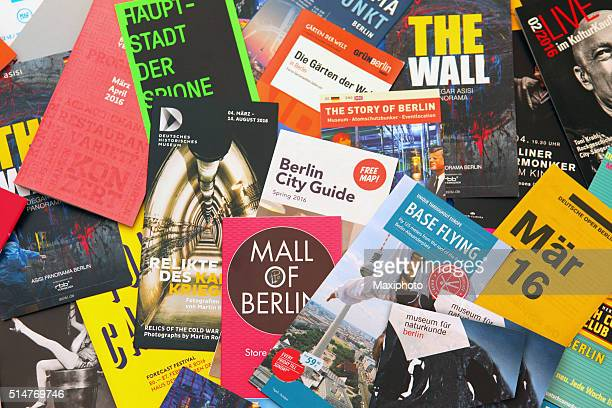 berlin tourist flyers, leaflets and advertisements to local events - flyer leaflet stock photos and pictures