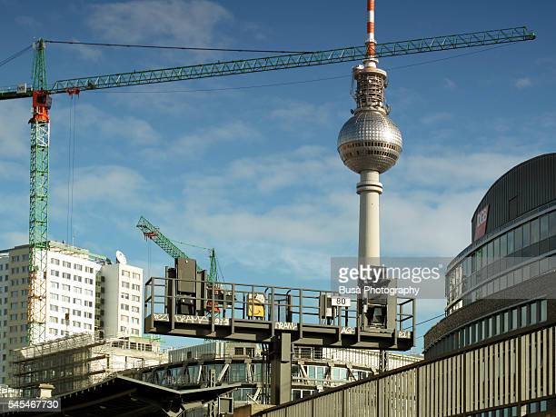 Berlin TV Tower, buildings, railway bridge and construction crane. Berlin, Germany