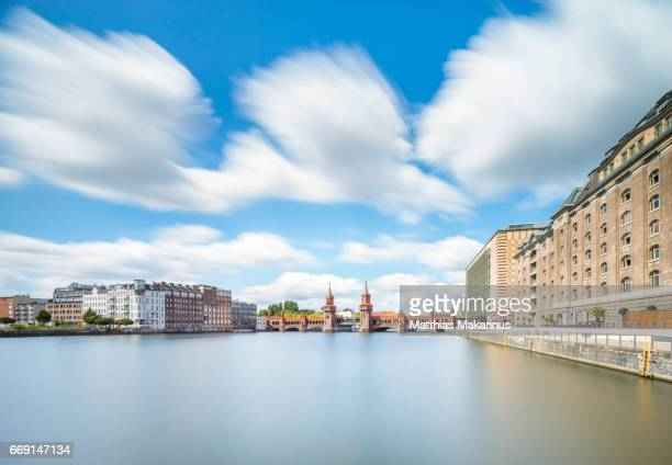 berlin urban summer day skyline with oberbaumbruecke - makarinus stock photos and pictures