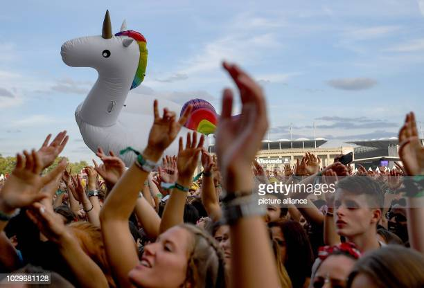 Visitors celebrate at the two-day music festival Lollapalooza on the grounds of the Olympic Park. Photo: Britta Pedersen/dpa