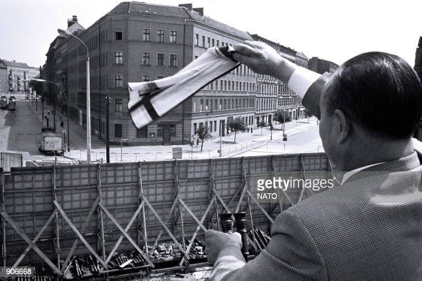 Berlin Wall Bernauerstrasse people waving to their relatives on the other side of the Wall August 1967 NATO celebrates its fiftieth anniversary on...