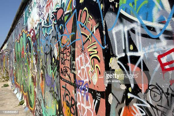 Berlin Wall covered with graffiti at the Eastside Gallery, Berlin, Germany, Europe