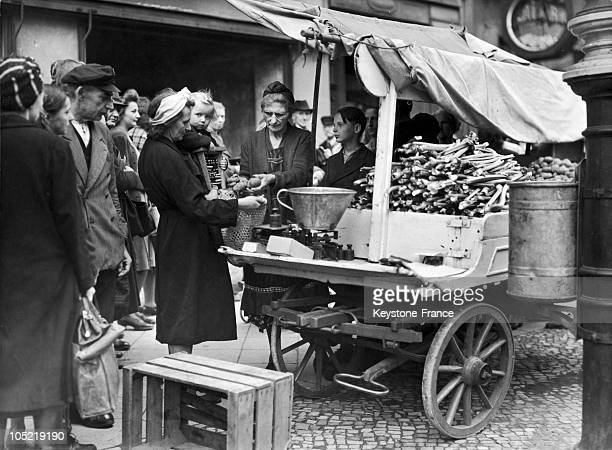 Berlin Woman Buying Eight Potatoes Which Represents Her FiveDay Food Ration For Herself And Her Five Children On August 17 1945