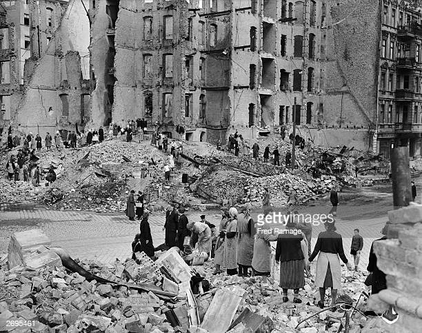 Berlin women work in a 'chain gang' to clear rubble in the war torn city.