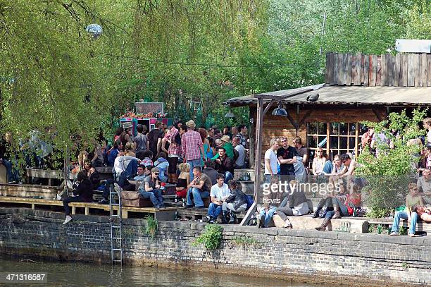 berlin youth sitting on graffiti place at spree river (germany) - friedrichshain stock photos and pictures