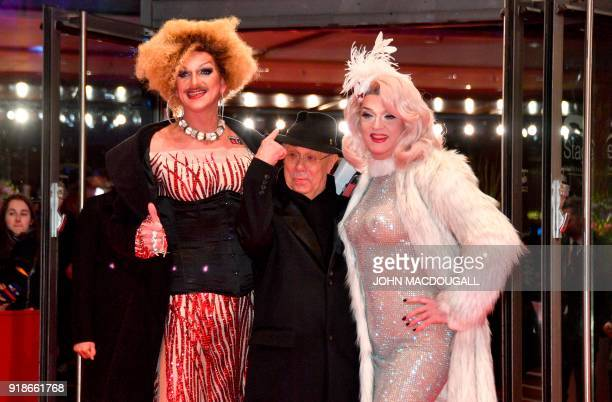 Berlinale Director Dieter Kosslick poses with German drag Queen Olivia Jones on the red carpet for the opening ceremony of the 68th Berlinale film...