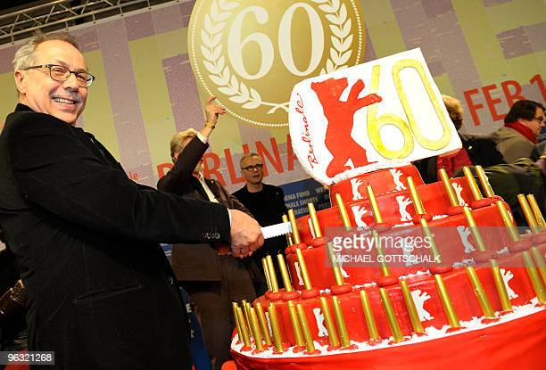 Berlinale festival director Dieter Kosslick cuts a birthday cake on February 1, 2010 in Berlin, ahead of the presentation of the 60th Berlin film...