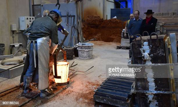 Berlinale film festival Director Dieter Kosslick and fourthgeneration Hermann Noack look at craftsmen work on various metal objects including the...