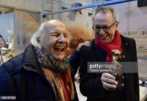Berlinale film festival Director Dieter Kosslick jokes with thirdgeneration Hermann Noack during the creation of the bear trophies for the upcoming...