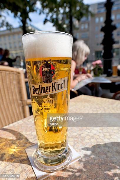 berliner kindl, glass of beer in berlin - pilsner stock photos and pictures