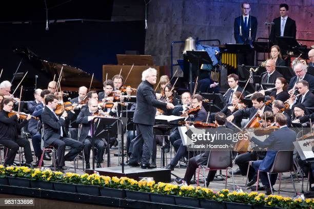 Berliner Philharmoniker with chief conductor Sir Simon Rattle perform live on stage during a concert at the Waldbuehne on June 24 2018 in Berlin...