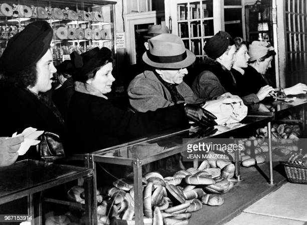 Berliner queue to buy rare and expensive products in a bakery in Berlin in December 1948 during the Berlin blockade.