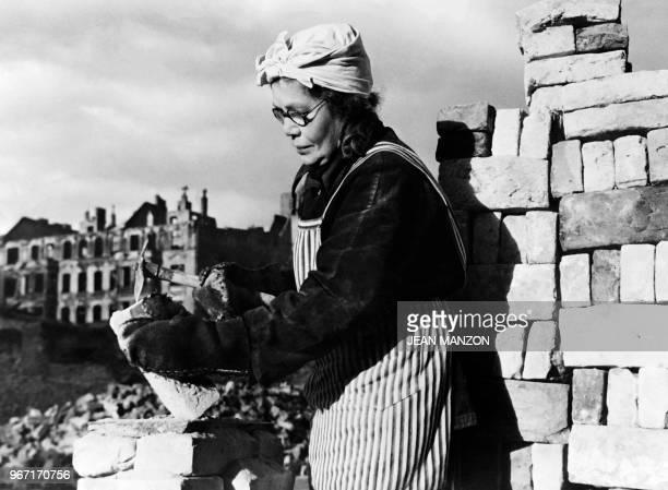 Berliner woman work in Berlin ruins to help the Western Allies rebuild West Berlin in December 1948 during the Berlin blockade.