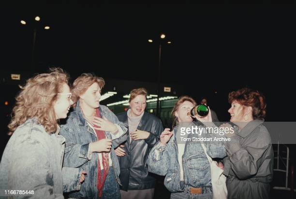 Berliners celebrate at Checkpoint Charlie on the night of 9th November 1989, when East Berliners were allowed to cross into the west for the first...
