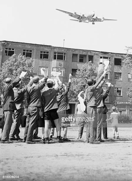 Berliners Hail Blockade Lifting Berlin Jubilant residents of Berlin wave to an American airlift plane approaching Tempelhof Airfield for a landing...