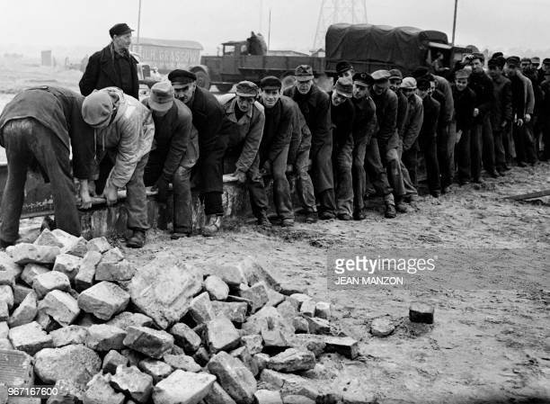 Berliners work to help the Western Allies rebuild West Berlin and facilitate communications in December 1948 during the Berlin blockade.