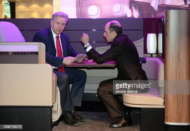 Berlin's acting mayor Klaus Wowereit talks to CEO of Qatar Airways Akbar Al Baker at the fair stand of Qatar Airways during the international tourism...