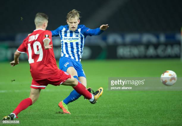 Berlin's Arne Maier and Zorya's Maksym Lunov vie for the ball during the Europa League group J soccer match between Hertha BSC and Zorya Luhansk at...