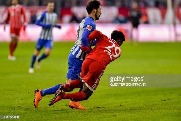 Berlin's Australian midfielder Mathew Leckie and Bayern Munich's French striker Kingsley Coman vie for the ball during the German first division...