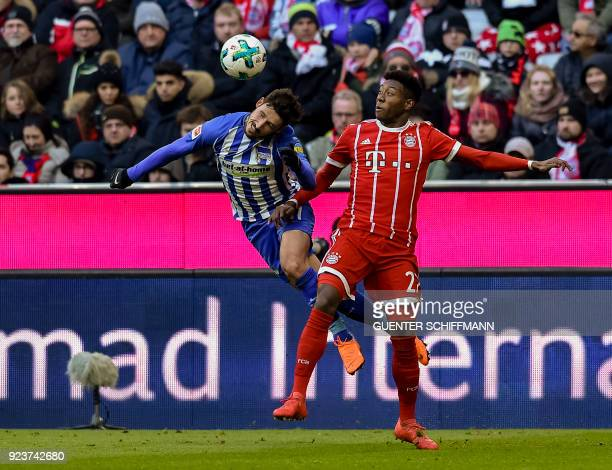 Berlin's Australian midfielder Mathew Leckie and Bayern Munich's Austrian midfielder David Alaba vie for the ball during the German first division...