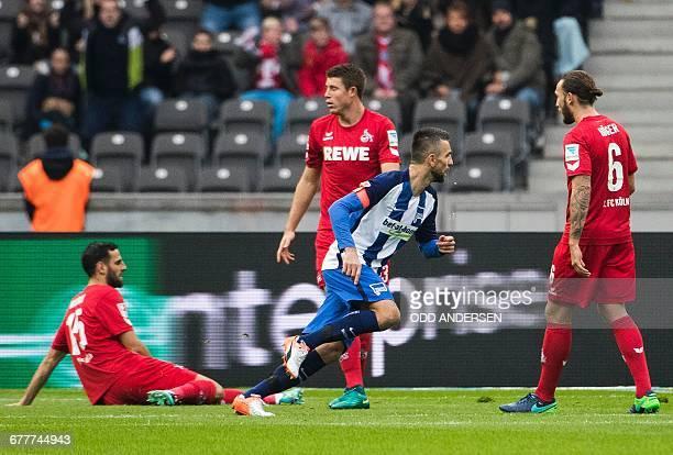 Berlin's Bosnian forward Vedad Ibisevic celebrates scoring the opening goal during the German first division Bundesliga football match between Hertha...