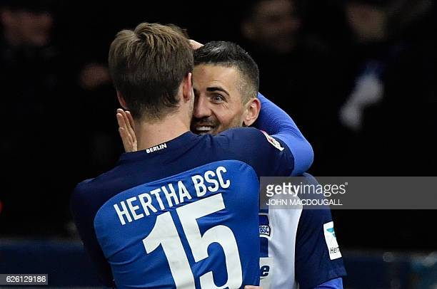 Berlin's Bosnian forward Vedad Ibisevic celebrates with Berlin's defender Sebastian Langkamp after he scored his second goal during the German first...