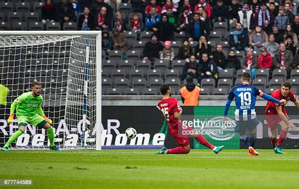Berlin's Bosnian forward Vedad Ibisevic scores the opening goal during the German first division Bundesliga football match between Hertha BSC Berlin...