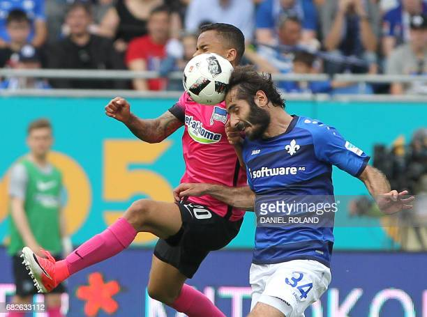Berlin's Brazilian midfielder Allan Rodrigues de Souza and Darmstadt's Turkish midfielder Hamit Altintop vie for the ball during the German first...