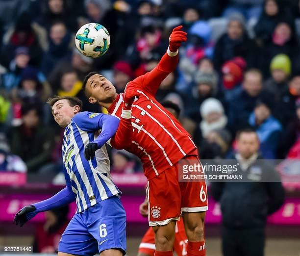Berlin's Czech midfielder Vladimir Darida and Bayern Munich's Spanish midfielder Thiago Alcantara vie for the ball during the German first division...
