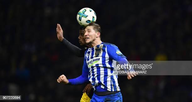 Berlin's Czech midfielder Vladimir Darida and Dortmund's Swedish forward Alexander Isak head for the ball during the German first division Bundesliga...