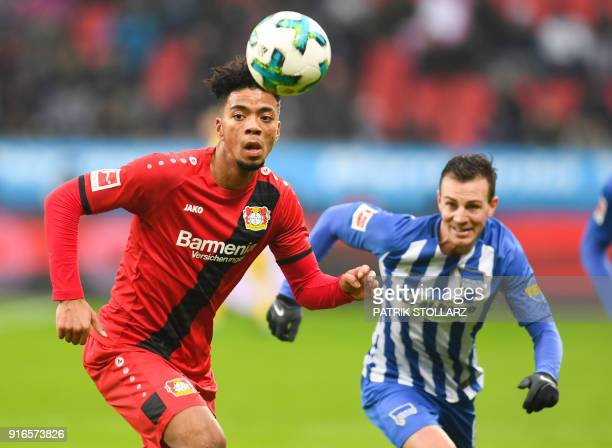 Berlin's Czech midfielder Vladimir Darida and Leverkusen's German defender Benjamin Henrichs vie for the ball during the German first division...