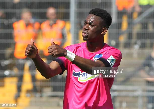 Berlin's defender Jordan Torunarigha celebrates scoring the 20 during the German first division Bundesliga football match between SV Darmstadt and...