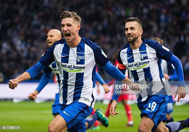 Berlin's defender Niklas Stark celebrates scoring his side's 2nd goal during the German first division Bundesliga football match between Hertha BSC...