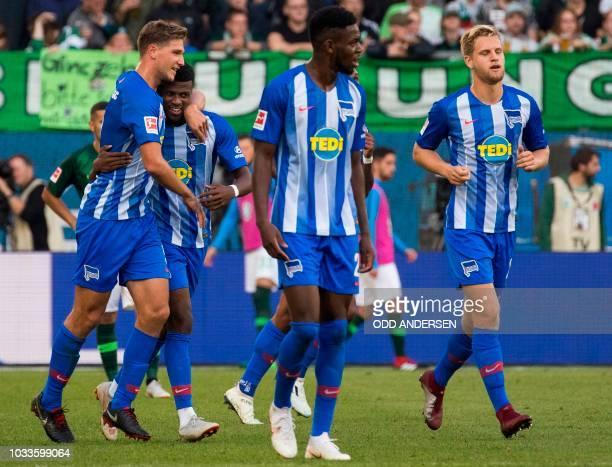 Berlin's Dutch forward Javairo Dilrosun celebrates scoring his team's first goal during the German First division Bundesliga football match between...