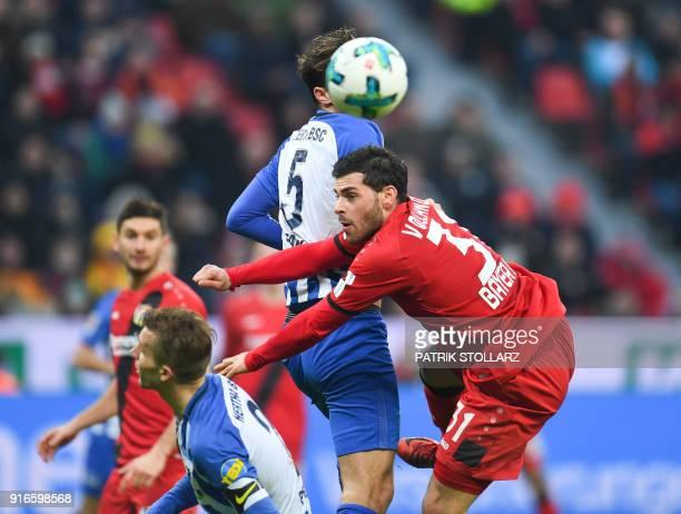 Berlin's German defender Niklas Stark and Leverkusen's German forward Kevin Volland vie for the ball during the German first division Bundesliga...