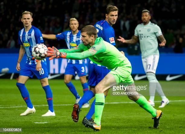 Berlin's German goalkeeper Thomas Kraft makes a save during the German first division Bundesliga football match Hertha Berlin v Bayern Munich at the...