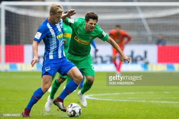 Berlin's German midfielder Arne Maier and Moenchengladbach's German midfielder Jonas Hofmann vie for the ball during the German first division...