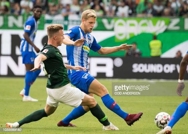 Berlin's German midfielder Arne Maier and Wolfsburg's German defender Yannick Gerhardt vie for the ball during the German First division Bundesliga...