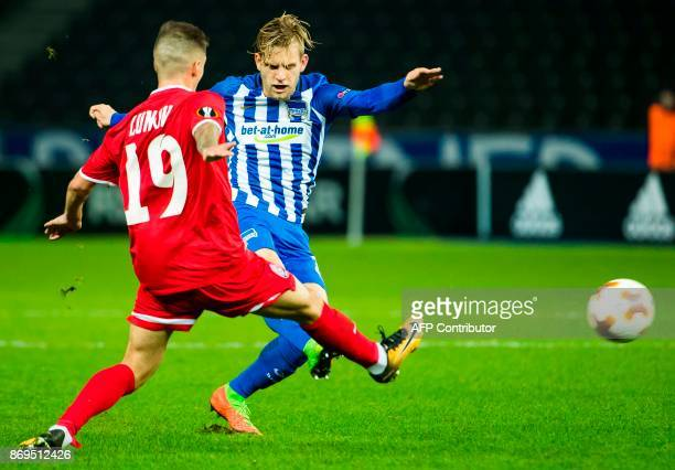Berlin's German midfielder Arne Maier and Zorya Luhansk's midfielder from Ukraine Maksym Lunyov for the ball during the UEFA Europa League football...