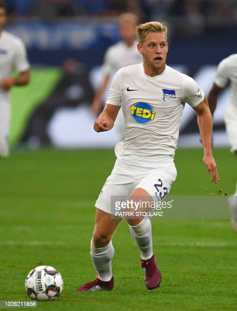 Berlin's German midfielder Arne Maier plays the ball during the German first division Bundesliga football match FC Schalke 04 vs Hertha Berlin in...