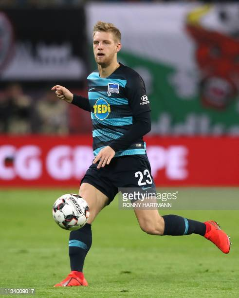 Berlin's German midfielder Arne Maier runs with the ball during the German first division Bundesliga football match between RB Leipzig and Hertha...