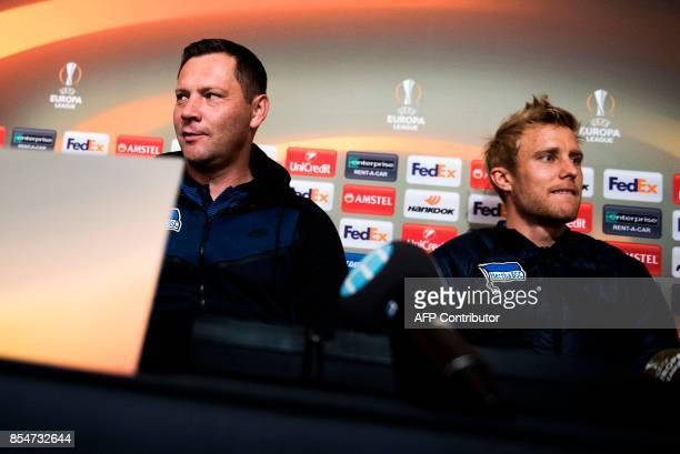 Berlin's Hungarian head coach Pal Dardai and Berlin's Norwegian midfielder Per Ciljan Skjelbred attend apress conference at Jamtkraft Arena in...