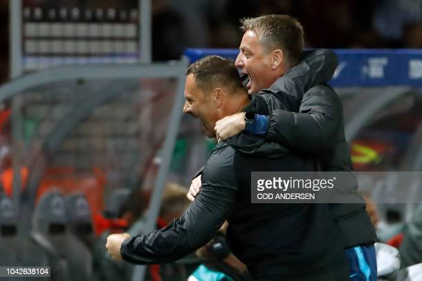 Berlin's Hungarian head coach Pal Dardai celebrates with his assistant coach Rainer Widmayer at the final whistle of the German first division...