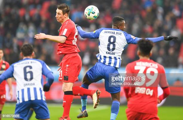 Berlin's Ivorian forward Salomon Kalou and Leverkusen's German midfielder Dominik Kohr vie for the ball during the German first division Bundesliga...