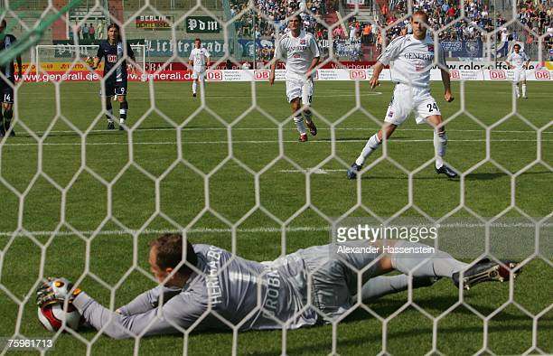 Berlins keeper Jaroslav Drobny safes a penalty shot by Robert Lechleitner of Unterhaching during the German Football Association Cup first round...