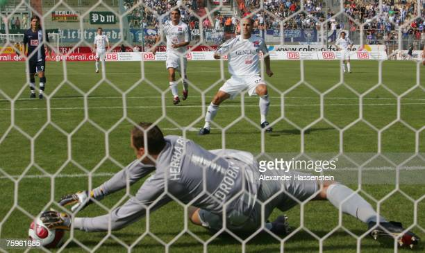 Berlins keeper Jaroslav Drobny saves a penalty shot by Robert Lechleitner of Unterhaching during the German Football Association Cup first round...