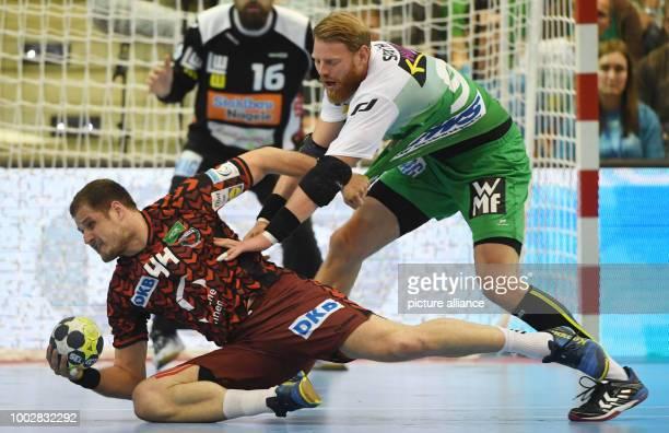 Berlin's Kresimir Kozina in action with Göppingen's Manuel Späth during the EHFCup handball final match between Berlin Füchse and Frisch Auf...